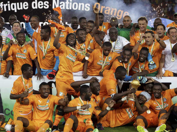 Ivory Coast soccer players celebrate with the trophy after winning their African Cup of Nations final match against Ghana