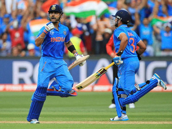 Virat Kohli (left) celebrates his century