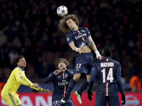 PSG's David Luiz heads the ball during the Champions League round of 16 first leg soccer match between Paris Saint Germain and Chelsea