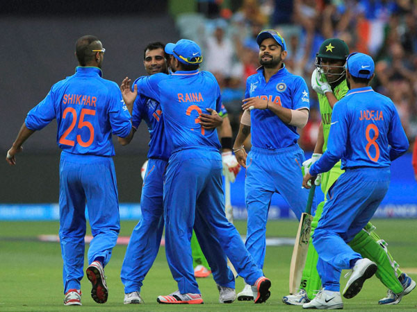 Indian players celebrate a Pakistan wicket in their WC opener