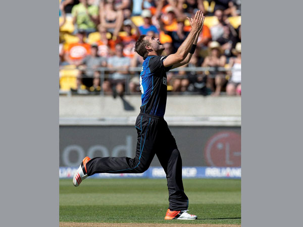 New Zealand's Tim Southee celebrates after taking his seventh wicket