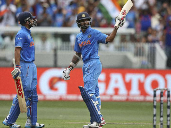 Shikhar Dhawan (right) gets to 50 and goes on to score 137