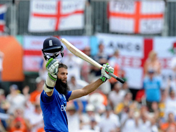 England's Moeen Ali waves to the crowd after reaching a century during their World Cup match against Scotland