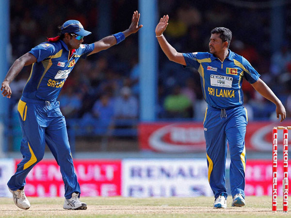 File photo: Rangana Herath (right) celebrates a wicket during a ODI