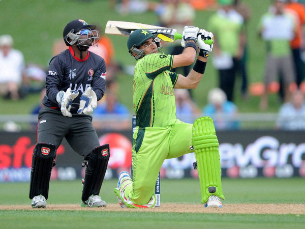 Pakistan's Misbah Ul Haq plays a shot as United Arab Emirates wicketkeeper Swapnil Patil watches during their World Cup match in Napier