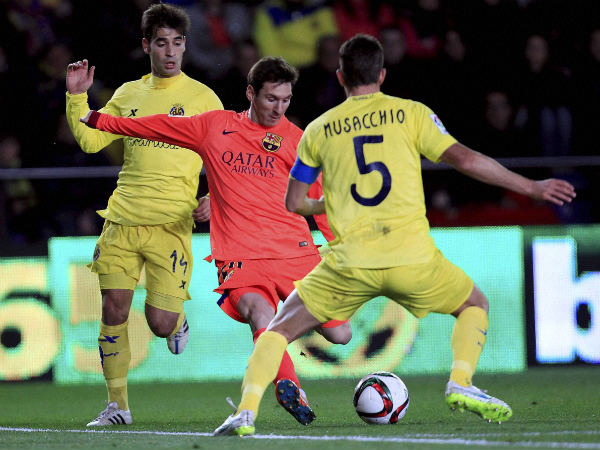 Lionel Messi (centre) of Barcelona in action against Villarreal