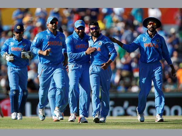 Indian players celebrate a wicket