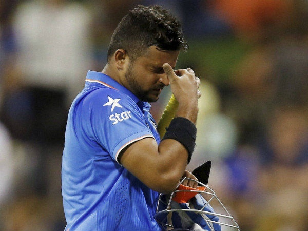 Raina walks back to the pavilion after making 22 against West Indies
