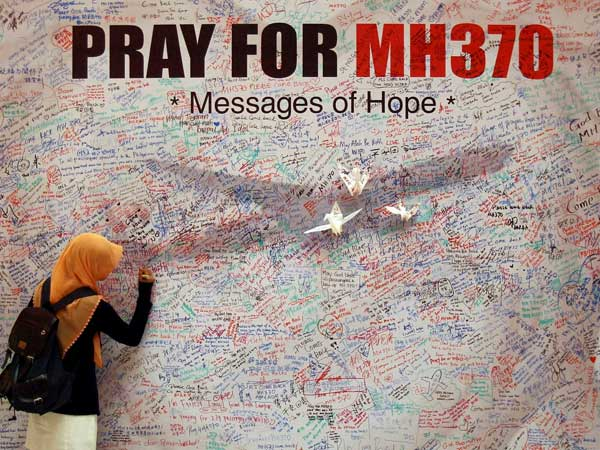 MH370 passengers' kin urge search resumption