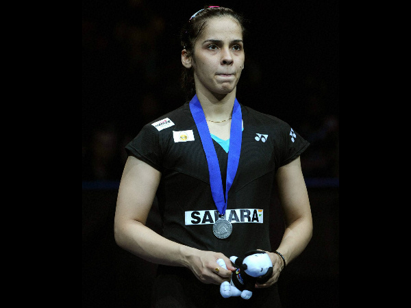 Saina poses with her silver medal after losing the final