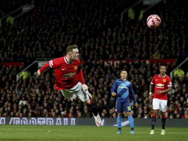 Manchester United's Wayne Rooney heads the ball and scores the opening goal of the game against Arsenal in FA Cup