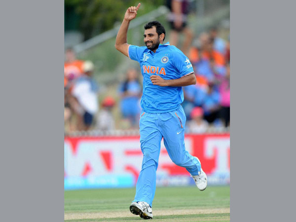 Shami celebrates after taking a wicket of Ireland batsman