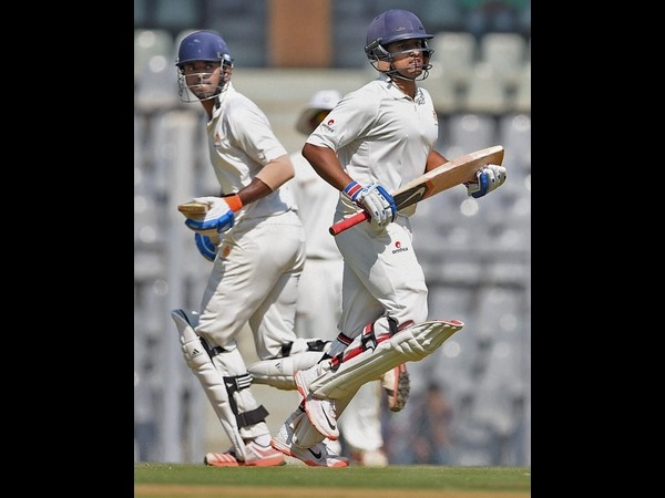 Rahul (left) and Karun run between the wickets during their partnership