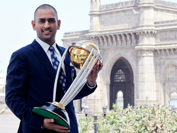 Dhoni with the 2011 World Cup trophy
