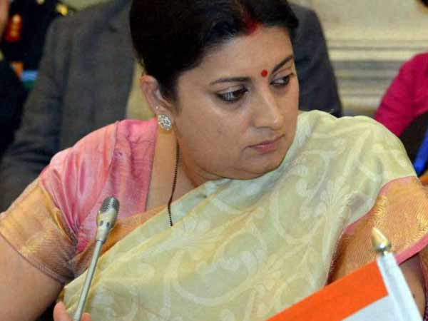 BJP member embarrasses govt over low literacy level, Smriti Irani cautions leader to speak carefully.