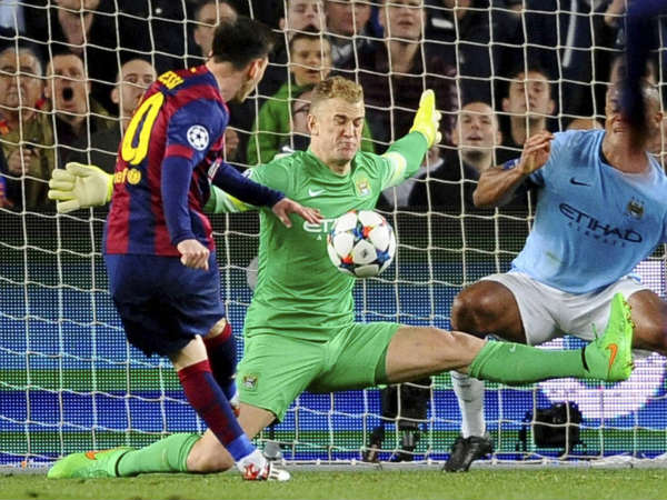 Manchester City's goalkeeper Joe Hart (center) and Manchester City's Vincent Kompany (right) save against Barcelona's Lionel Messi (left)