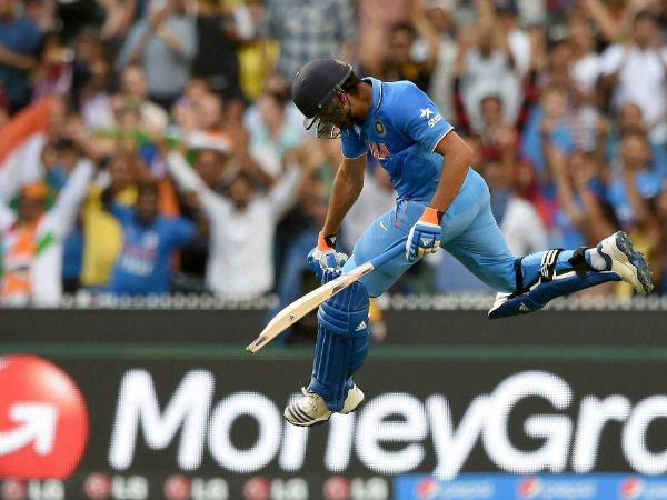 Rohit Sharma celebrates after scoring a century against Bangladesh