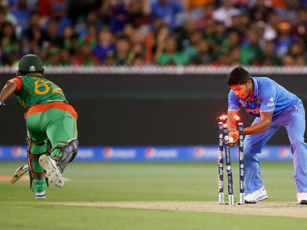 Umesh Yadav (right) runs out Bangladesh's Imrul Kayes during their 2nd quarter-final match