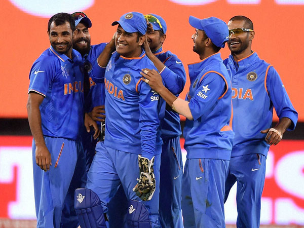Dhoni and his team-mates are happy after taking a Bangladesh wicket