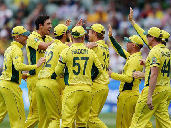 Australian players congratulate Mitchell Starc (second left) after he took the wicket of Pakistan's Sarfaraz Ahmed