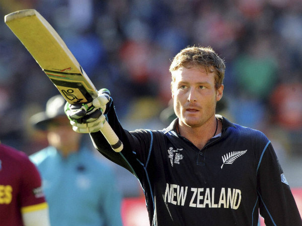 Martin Guptill waves his bat as he heads back to the pavilion 237 not out