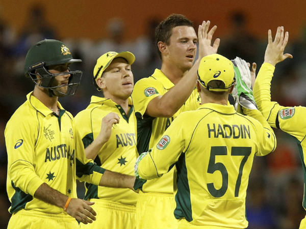 Josh Hazlewood (centre) celebrates with teammates during World Cup 2015
