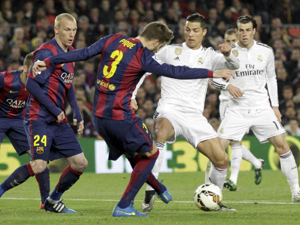 Barcelona and Real Madrid players in action in La Liga