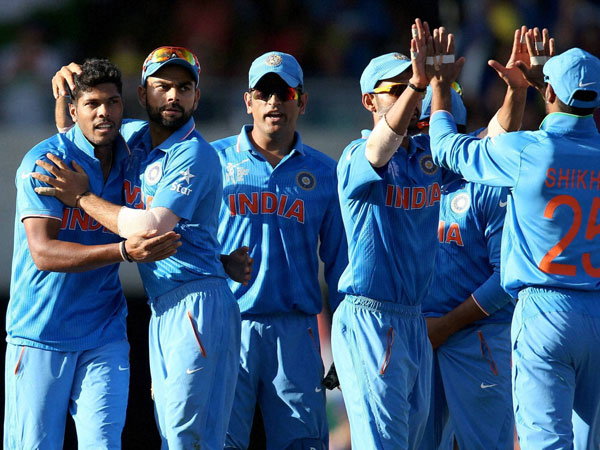 Indian players celebrate after the dismissal of one of Australia's batsman