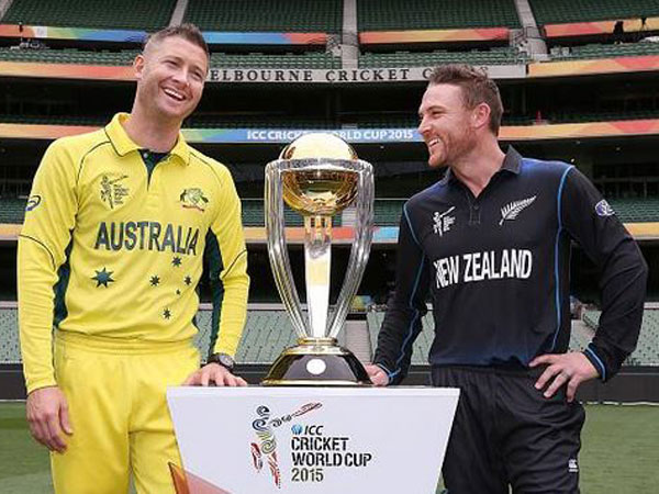Captains Clarke (left) and McCullum pose in front of the World Cup trophy on Saturday