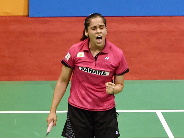 Saina Nehwal celebrates against Japan's Yui Hashimoto during the Semi final (women single) match for the Yonex Sunrise India Open 2015