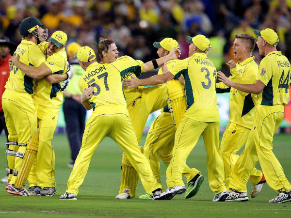 Australian players celebrate after they defeated New Zealand by seven wickets to win the Cricket World Cup final in Melbourne