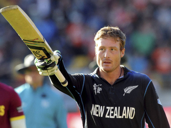 Martin Guptill waves his bat as he leaves the field after scoring 237 not out against the West Indies in World Cup 2015