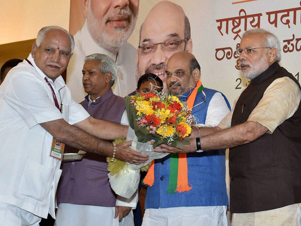 Prime Minister Narendra Modi being presented a bouquet