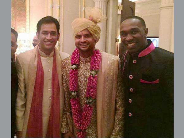 Cricketers MS Dhoni and D Bravo at the marriage ceremony