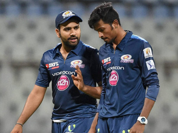 Mumbai Indians captain Rohit Sharma (left) intracts with one of his players