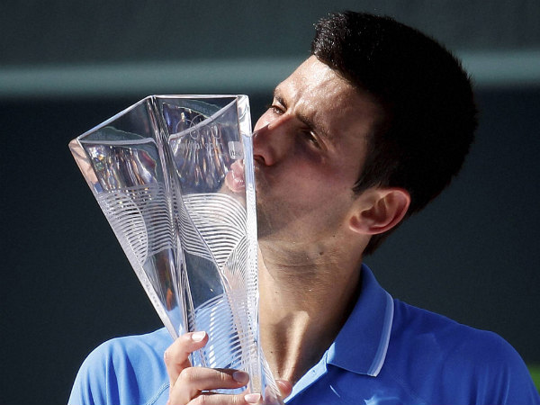 Novak Djokovic kisses the trophy after he defeated Andy Murray in the men's final of Miami Open