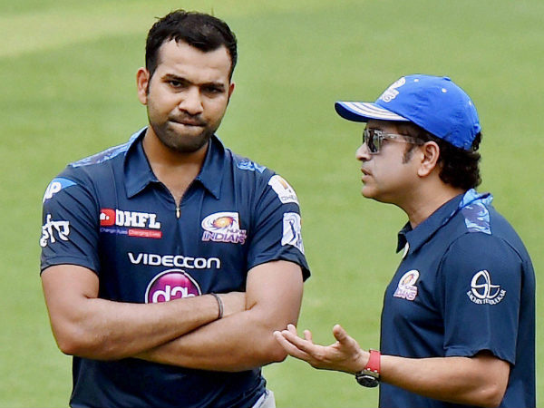 Mumbai Indians captain Rohit Sharma (left) and team icon Sachin Tendulkar discuss during their training session at Eden Garden
