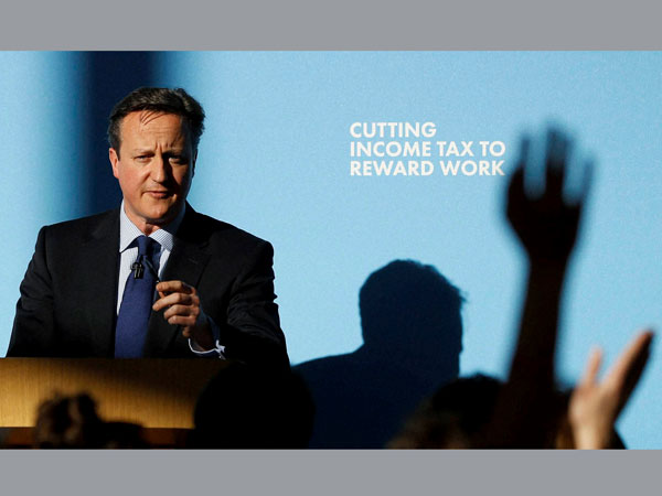 Britain's Prime Minister David Cameron answers questions