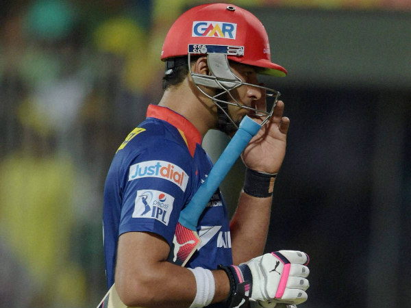 Yuvraj Singh walks back to the pavilion after being dismissed for 9