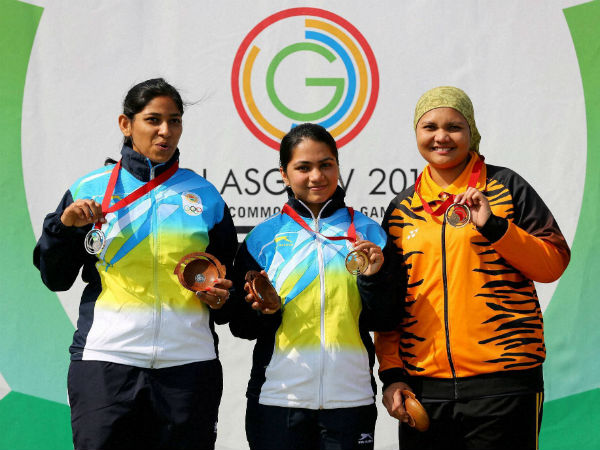 File photo: Gold medallist Apurvi Chandela, centre, poses for with teammate and silver medallist Ayonika Paul, left, and bronze medallist Nur Suryani Mohamed Taibi of Malaysia, following the 10m Rifle Women Final at the 2014 Commonwealth Games in Glasgow, Scotland, on July 26, 2014