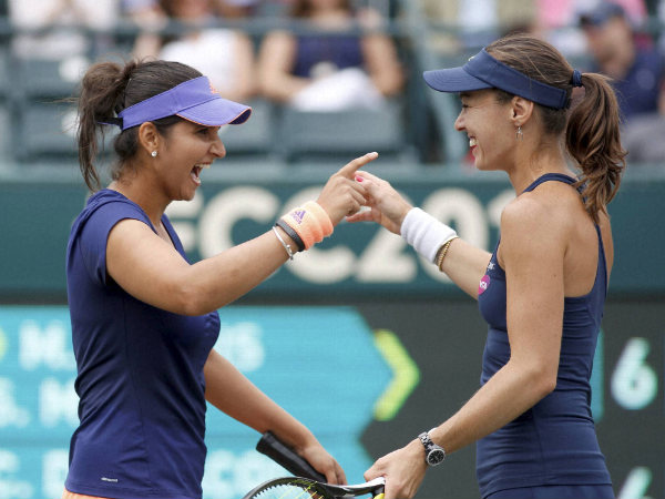 Sania Mirza (left) and her teammate Martina Hingis congratulate each other after winning WTA Family Cup