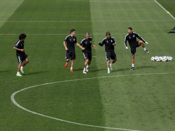 Real Madrid's players run during a training session in Madrid