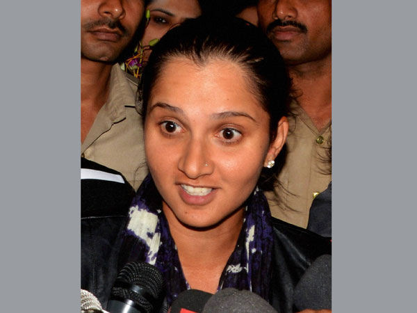 Sania Mirza talks with the media on her arrival at airport in Hyderabad on Tuesday