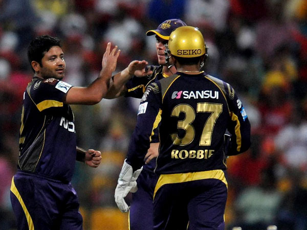 File photo: Piyush Chawla (left) celebrates a wicket with team-mates at IPL 2015