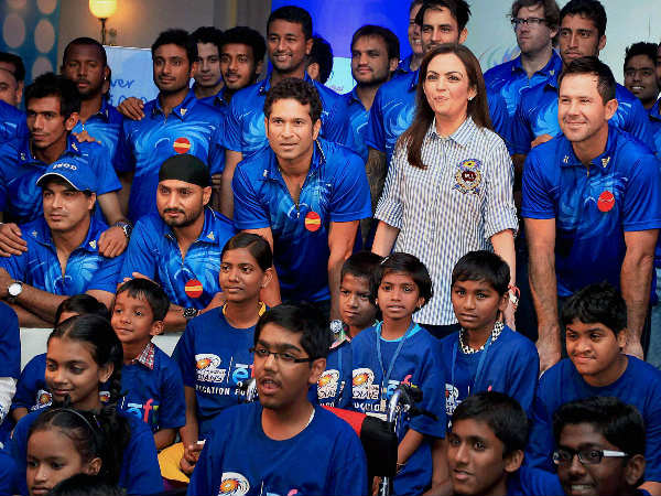 Mumbai Indians team owner Nita Ambani along with Sachin Tendulkar, Ricky Ponting and other teammates during an event for underprivileged children 'Education For All' in Mumbai in this 2013 file photo