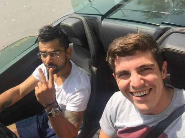 Kohli (left) and Abbott in the former's Lamborghini (Picture from Abbott's Twitter page)