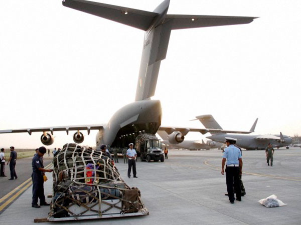 Relief Material Is Loaded Into An Indian Air Force Aircraft Headed To Nepal