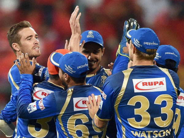 Tim Southee (left) celebrates with team-mates after dismissing Chris Gayle