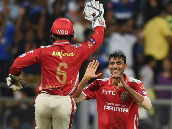 Axar Patel (right) celebrating a wicket with Wriddhiman Saha during IPL 2015