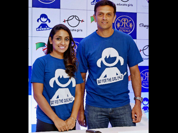 Rahul Dravid and former English cricketer Isa Guha during a press conference to extend support towards the development and welfare of the Girl Child, in Mumbai.